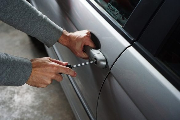 Automotive Key Management Systems Prevent Theft - Car Thief Breaking into Car