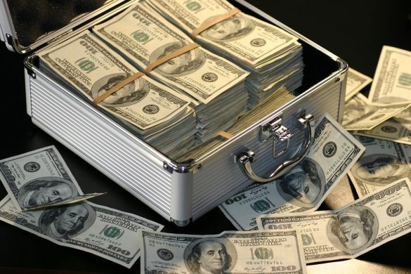 Automotive key management systems can save thousands - Image of briefcase full of 100 dollar bills